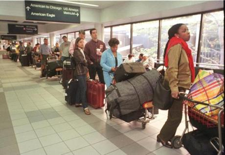 A long line of American Airlines passengers wait Monday morning, Sept. 17, 2001 at Boston's Logan International Airport, to check in with their baggage for flights around the country. (AP Photo/Julia Malakie) 10logan airlinegallery